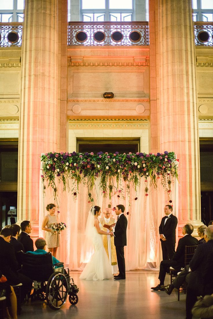 How beautiful is the backdrop for the ceremony www.stylemepretty.com/midwest-weddings/2014/02/11/cleveland-city-hall-rotunda-wedding/
