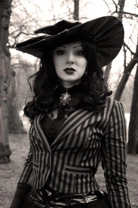 I did no whether to but this photo of this beautiful woman in goth or steampunk cuz she says Vintage gothic