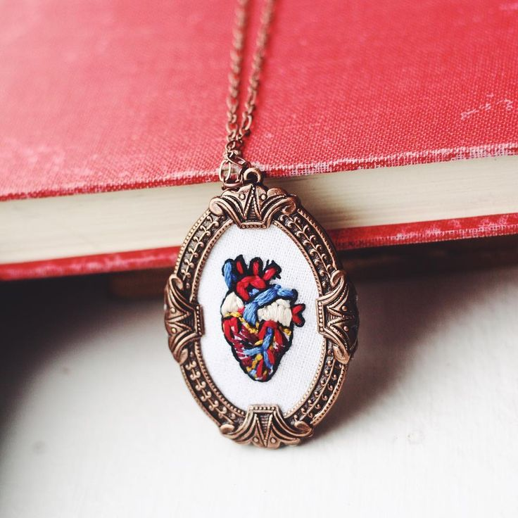 http://sosuperawesome.com/post/157119254032/embroidered-pendants-by-rachel-pruett-on-etsy