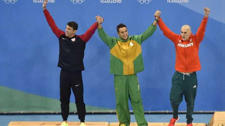 Reason for all the ties in swimming explained:     August 13, 2016   Michael Phelps (USA), Chad Guy Bertrand le Clos (RSA) and Laszlo Cseh (HUN) celebrate tying for the silver medal during the men's 100m butterfly final in the Rio 2016 Summer Olympic Games.