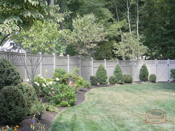 Privacy Screens | Vinyl Gallery | Colonial Fence Co. Norfolk, MA    Custom Taupe Colored Vinyl Fence  Diagonal Lattice Topper