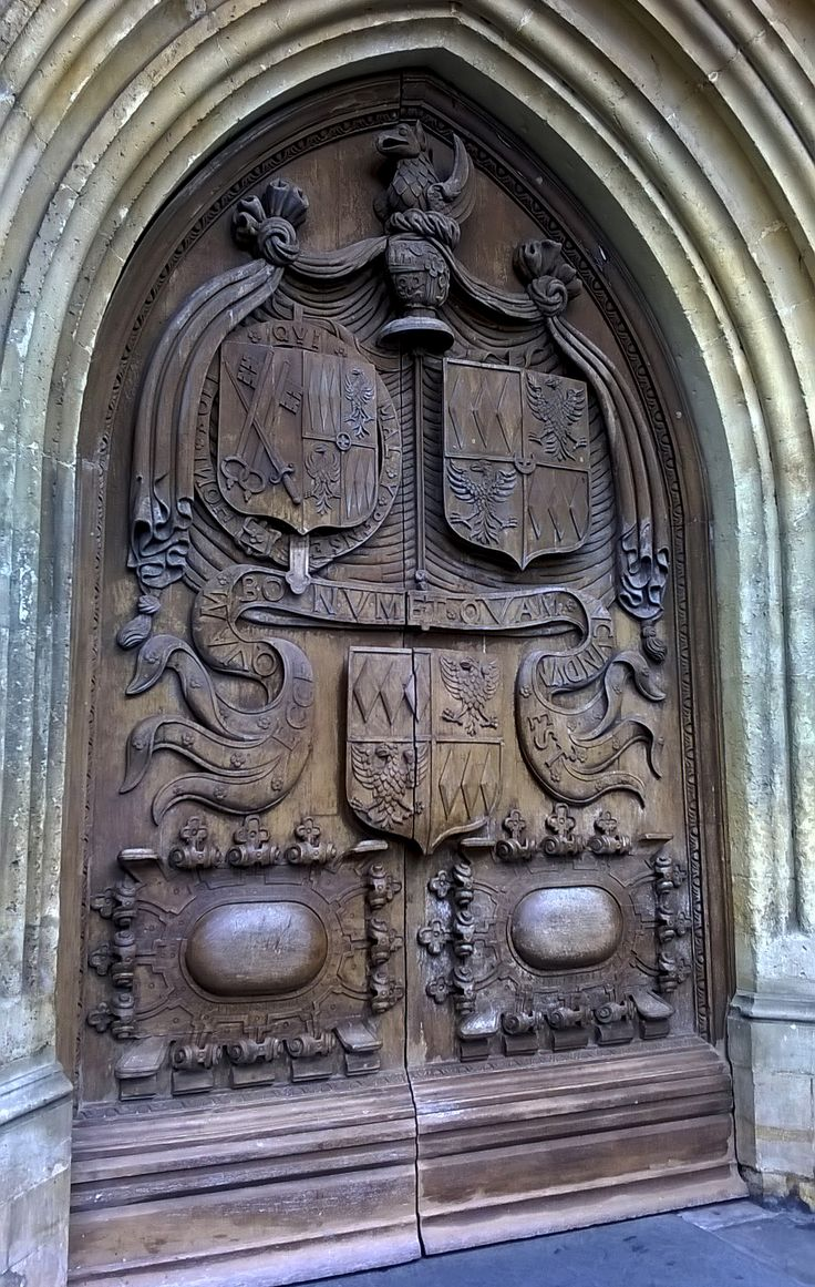 Carved wooden door at Bath Abbey ©AlexR