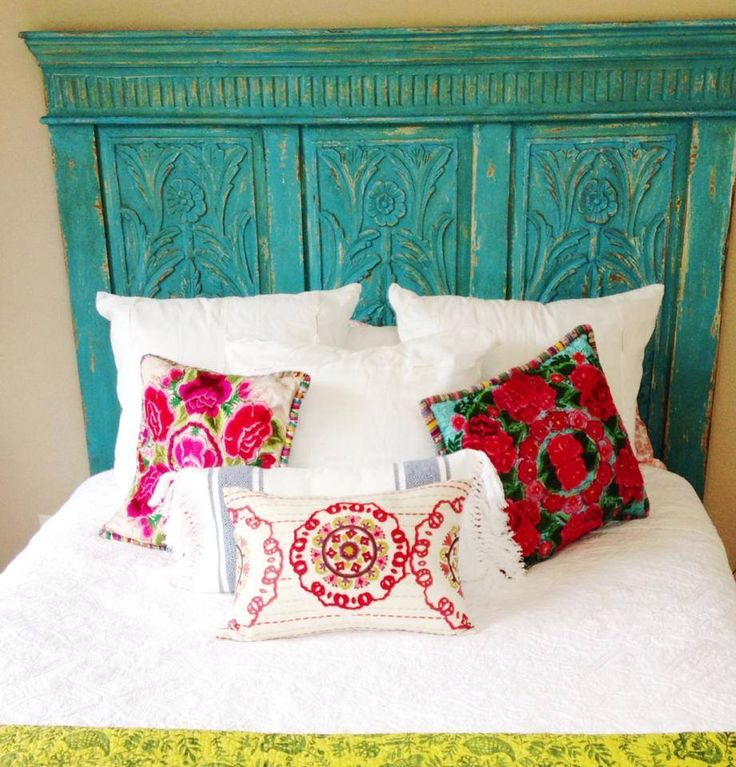 One of our customers added a pop of color to their bedroom with our turquoise headboard. We love how they paired it with bright textile cushions! #Nadeau #FWAS