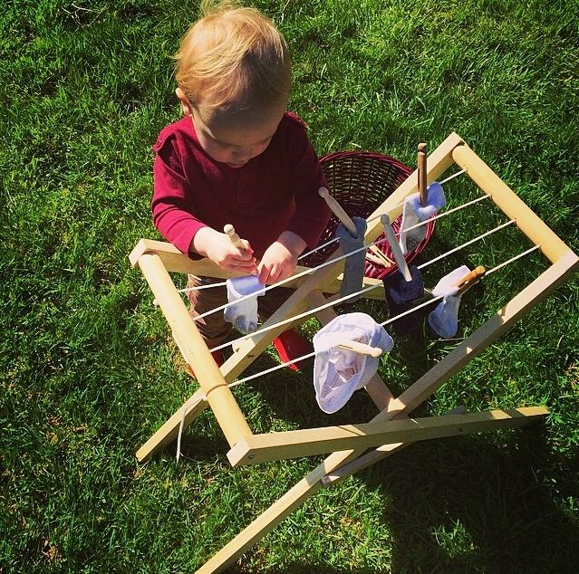 """""""The child can only develop fully by means of experience in his environment. We call such experiences 'work'."""" - Maria Montessori. Montessori Toddler Practical Life Activity: Handmade clothesline by my Father."""