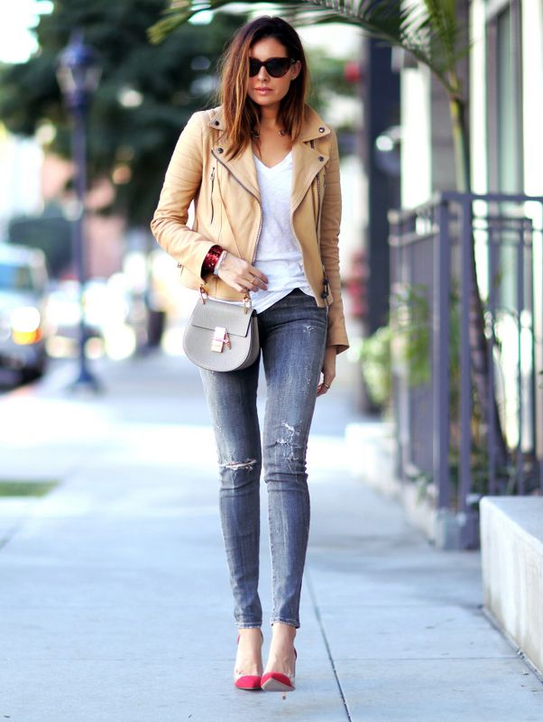 Erica Hoida is wearing a khaki classic leather moto jacket from Belstaff
