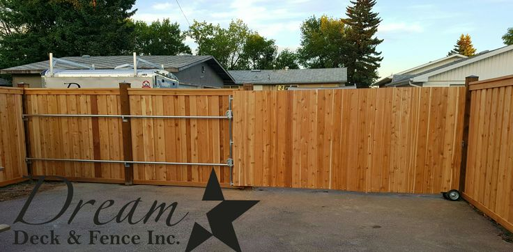 Fully Custom Cedar sliding gate on rollers 13ft wide perfect for A large RV. dreamdeckandfence.ca