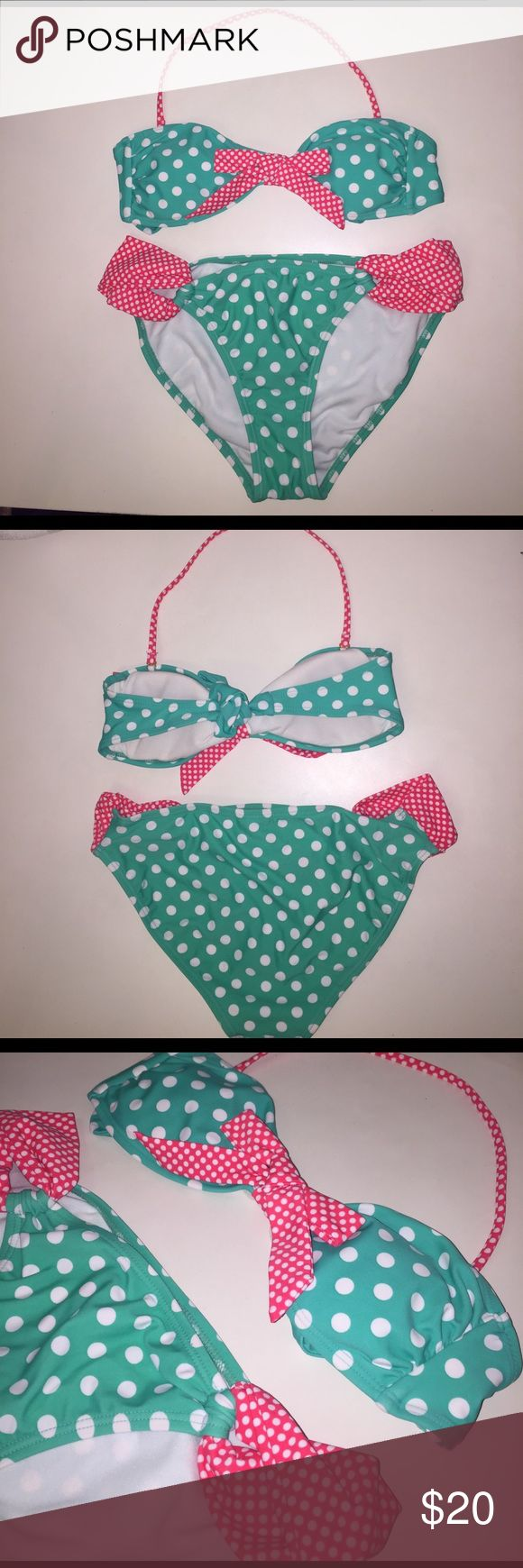 Polka Dot Bikini - Bandeau Top & Bikini Bottom This adorable polka dot bikini comes at the perfect time for Spring Break! The bandeau top can we be worn strapless or halter, has removable padding, and is tied at the back. No underwire. The bikini style bottom has peep holes at the hip for some peek-a-boo flair. Never worn, all tags still attached! Xhilaration Swim Bikinis