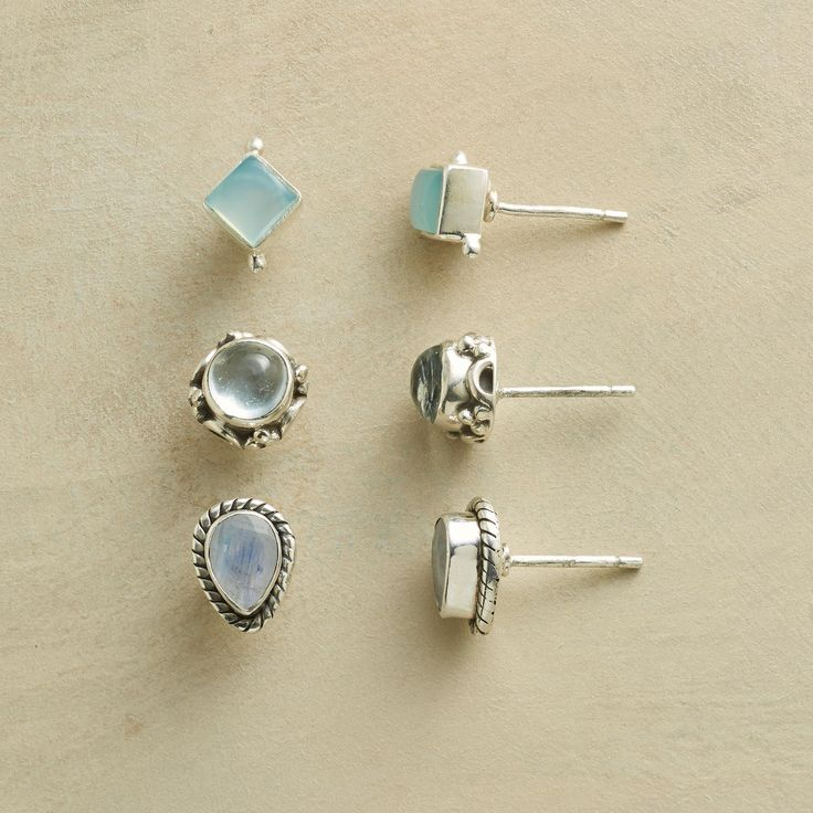 "FANCIFUL FRAMED EARRING TRIO -- Exhibit your good taste with sterling silver studs shining in moonstone, aquamarine and chalcedony. Exclusive. Set of 3. 5/16"" to 3/8""L."