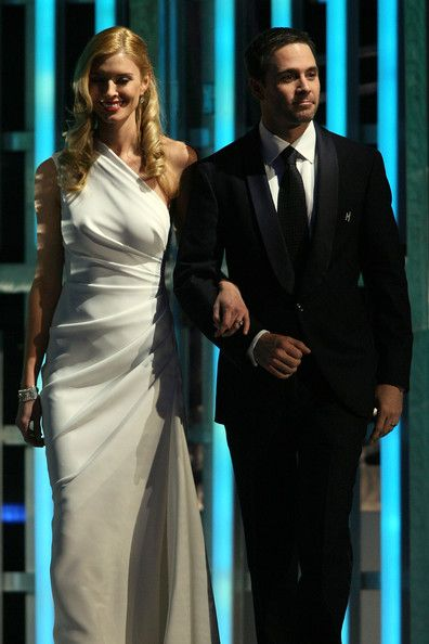 Four time NASCAR Sprint Cup Series Champion Jimmie Johnson (R) and his wife Chandra walk on stage during the 2009 NASCAR Sprint Cup Series awards banquet during the final day of the NASCAR Sprint Cup Series Champions Week on December 4, 2009 in Las Vegas, Nevada.