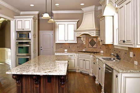 Our off white cabinets w glaze, flooring and granite #TyphoonBordeauxRiver w brushed oil bronze hardware