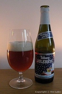 Bottle and glass of Tuborg Christmas Brew from the Denmark-pictures blog (in English).