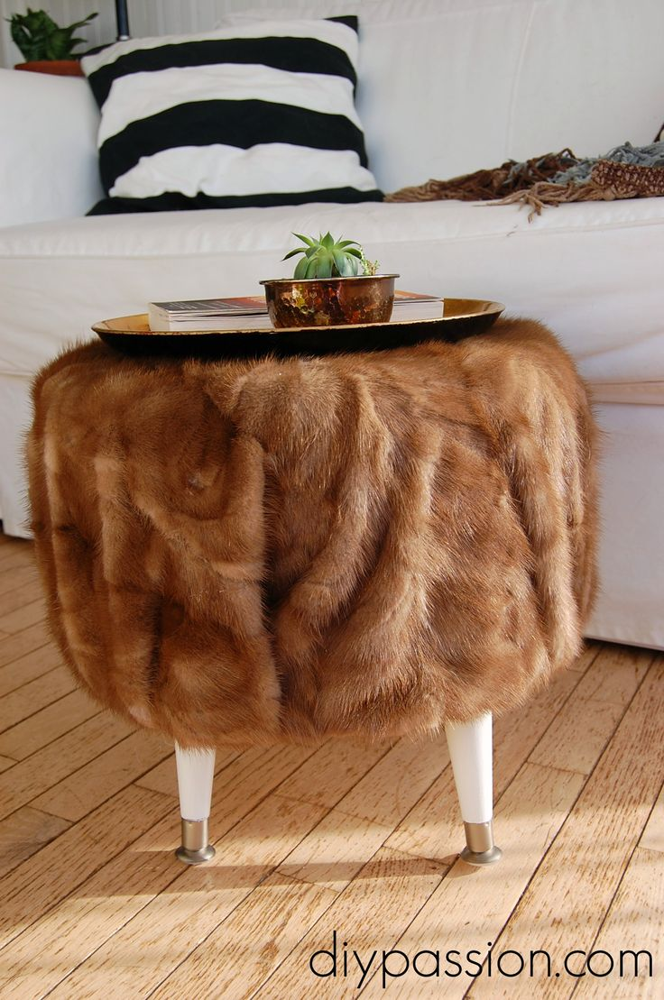 thrift store damaged fur coat + recycled cable spool = a fantastic fur covered ottoman!