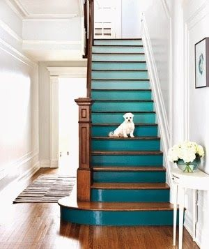 Consecutive colors on the same paint strip were used for this blue painted staircase.