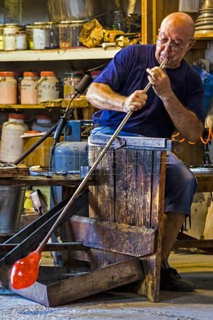 MURANO, ITALY - AUGUST, 5: Glassworker in action in the Murano glass factory on August 5, 2015.