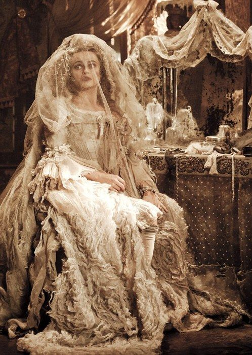 """Here's a first look at Helena Bonham Carter as Miss Havisham, the witchy central character in Great Expectations, Mike Newell's adaptation of Charles Dickens' novel. Miss Havisham is an iconic character over here in Britain: an embittered spinster who sits in her mouldering mansion still wearing the wedding dress she wore when she was jilted at the altar; she has trained her adopted daughter Estella to break men's hearts just as her heart was broken. Bonham Carter co-stars opposite Ralph…"