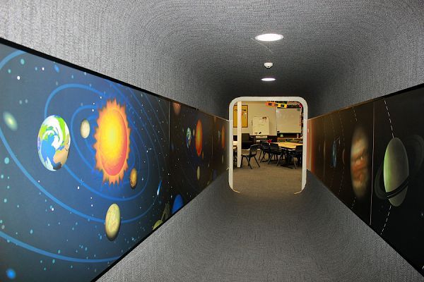 Pupils, parents and staff at Hawker Primary School in Canberra are over the moon with their planetary laminated wall murals and other spectacular custom laminate corridor designs- thanks to Wilsonart Australia Fig.1