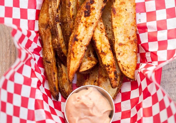 Skip traditional french fries and make baked potato wedges crusted in a parmesan and spice mixture. Serve with a sweet and tangy campfire sauce.