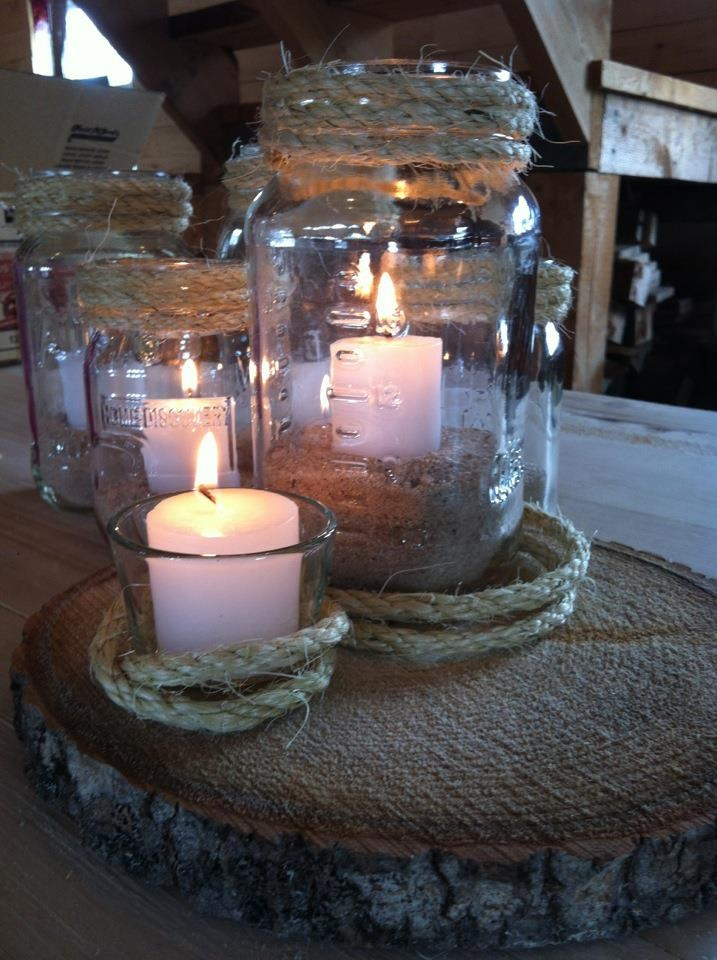 Rustic mason jar centerpieces sand candles rope and tree