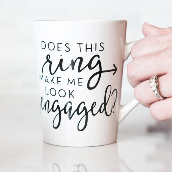 """Newly engaged? You need this adorable """"does this ring make me look engaged?"""" mug to let everyone know that you're taken! A great way to sip your favorite tea, coffee, or hot cocoa in style. Also perfe"""
