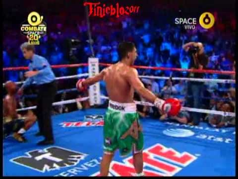Displaying lightning quick feints, jabs, and right crosses. Up & coming British superstar, Amir Khan dismantles Zab Judah, the former undisputed 140 lb champ,