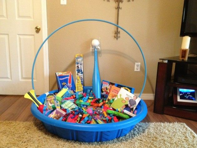 Family Easter basket idea... kiddie pool filled with summer toys for all kids!