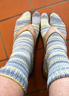 A split toe/tabi style sock designed to be worked …
