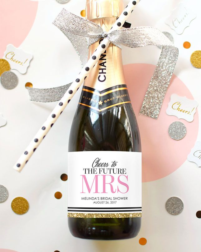 Customize mini champagne bottle labels for a bachelorette party favor your bridesmaids will definitely use.