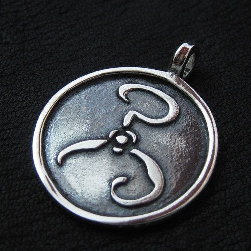"Silver ""Yellow Sign"" pendant from The Sunken City by DaWanda.com"