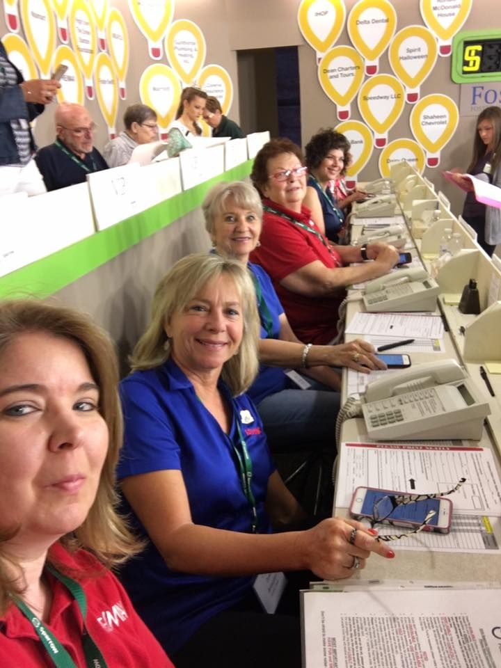 Dewitt MI REMAX Real Estate Agency volunteering at the Telethon to support the Greater Lansing Michigan Sparrow Children's Health Center