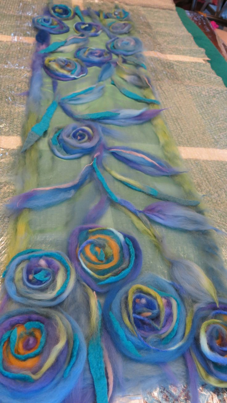 GB...work in progress...I think to machine felt this, you'd have some pinning to do--as the piece is very large. But once you get going on a felting sewing machine, it would go much faster than nuno felting!!!