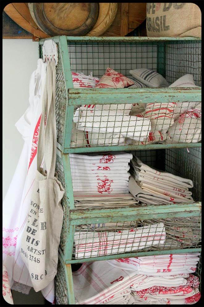 Long narrow half-closed bins for linens. (Hall, bath, and/or kitchen.) Small hooks on side to store bags, washcloth, hand-towel, dish-towel, etc.