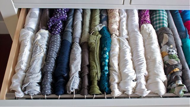 Hang shirts in your drawers using metal rods to eliminate the need to fold and make your clothes more accessible. #organize