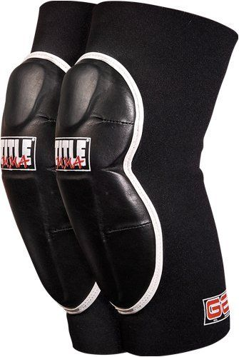 """TITLE MMA Gel Striking Elbow Guard, L by Title Boxing. $29.99. The best training option for all MMA training and grappling workouts. Exclusive Gel Enforced Lining® with added layers of high and low density foam padding offer the ultimate in performance, protection, comfort and security. Gel lining over the knee and elbow are covered with a tough contoured synthetic cover to offer round after round of uninhibited and unrestricted use. Full 1/8"""" form fitting neoprene ..."""