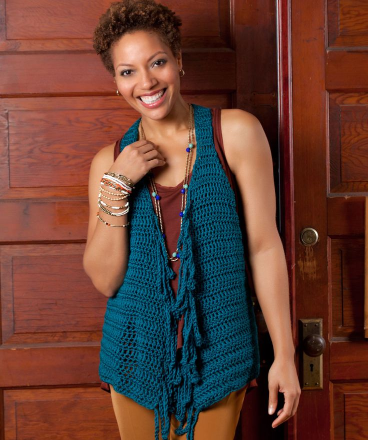 Flattering to your figure, this clever vest features long chained fringe at the front edges and over-defined armholes. It can be crocheted quickly to update the pieces already in your closet.
