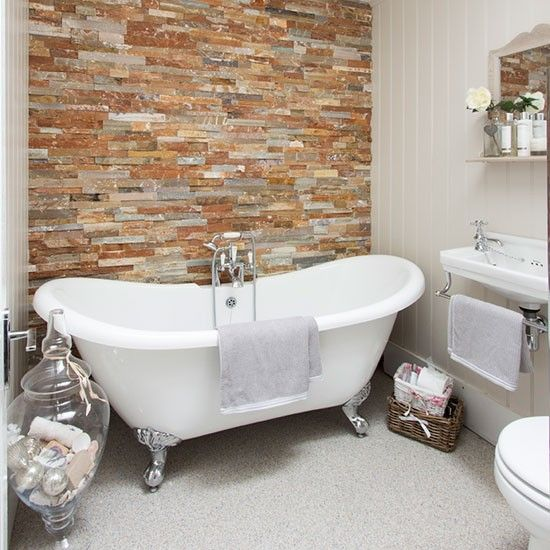 The bathroom is a good place to try out a slightly different look. Here, bare brickwork makes for an eye-catching feature above the roll-top bath.