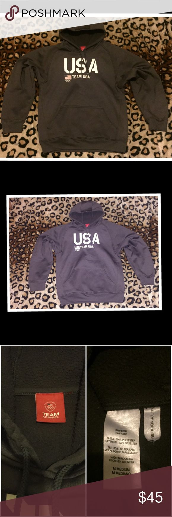 Authentic U.S. Olympic committee team apparel Authentic 2011 U.S. Olympic pull over hoodie. Show your Olympic spirit with this pullover hoodie. Great condition, no flaws. color is charcoal grey. Made with 100% polyester team apparel Sweaters