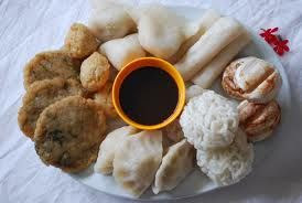 Pempek Palembang (South Sumatra Province), mpek-mpek or empek-empek is a savoury fishcake, made of fish and tapioca, served with yellow noodles and a dark, rich sweet and sour sauce called kuah cuka or kuah cuko (vinegar sauce)