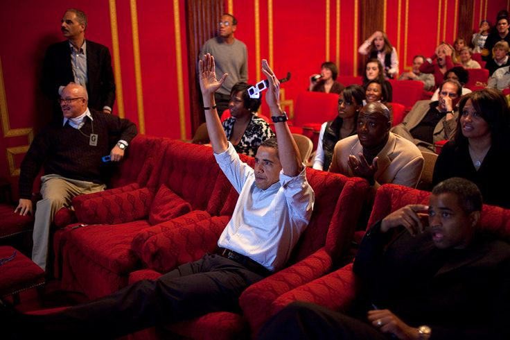 12. Obama catches the Super Bowl game with colleagues in the White House theater. 56-president-barack-obama-holds-3-d-glasses-while-watching-the-super-bowl-game-at-a-super-bowl-party