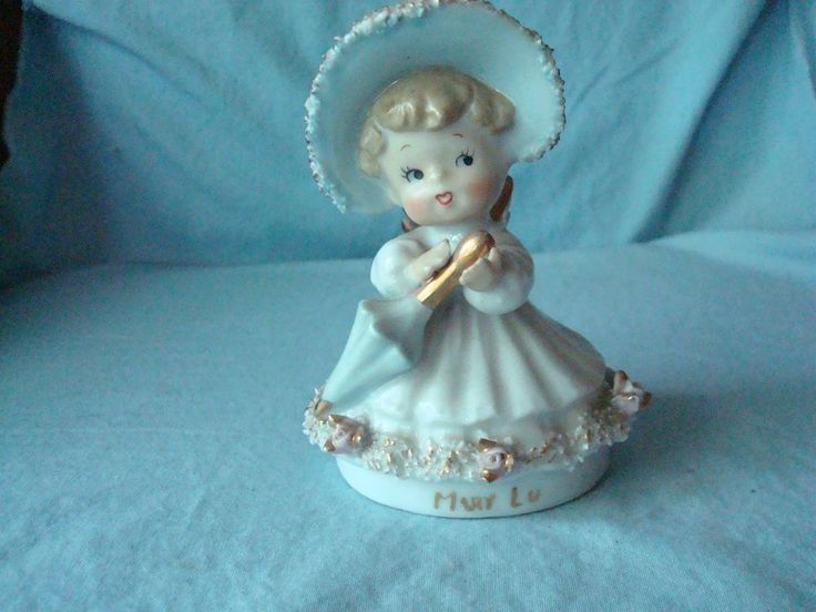 """Vintage Angel Girl Figure with Blue Umbrella-Spaghetti. Made inJapan. She has """"Mary Lu"""" printed in gold. She is about 4 3/4"""" tall and has no chips or cracks. There is rubbing off of the gold on her wings. 