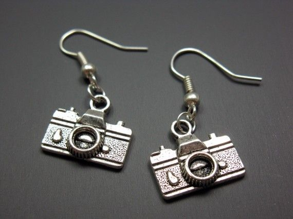 Hey, I found this really awesome Etsy listing at http://www.etsy.com/listing/65594268/camera-earrings-geek-jewelry-funny