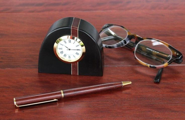 This cute desk clock is so solid and compact it almost sits on its base with an air of smugness - an