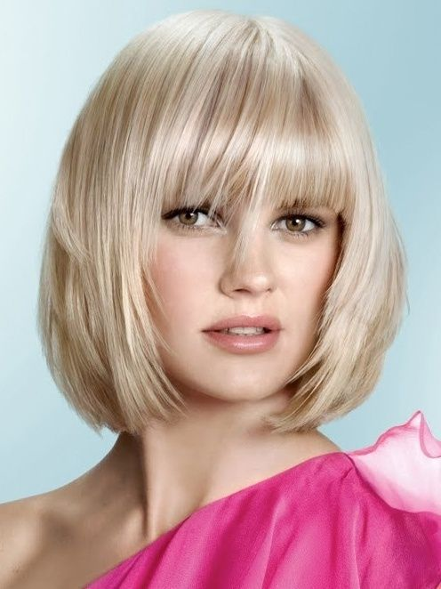 Cute lightly layered bob with full bangs