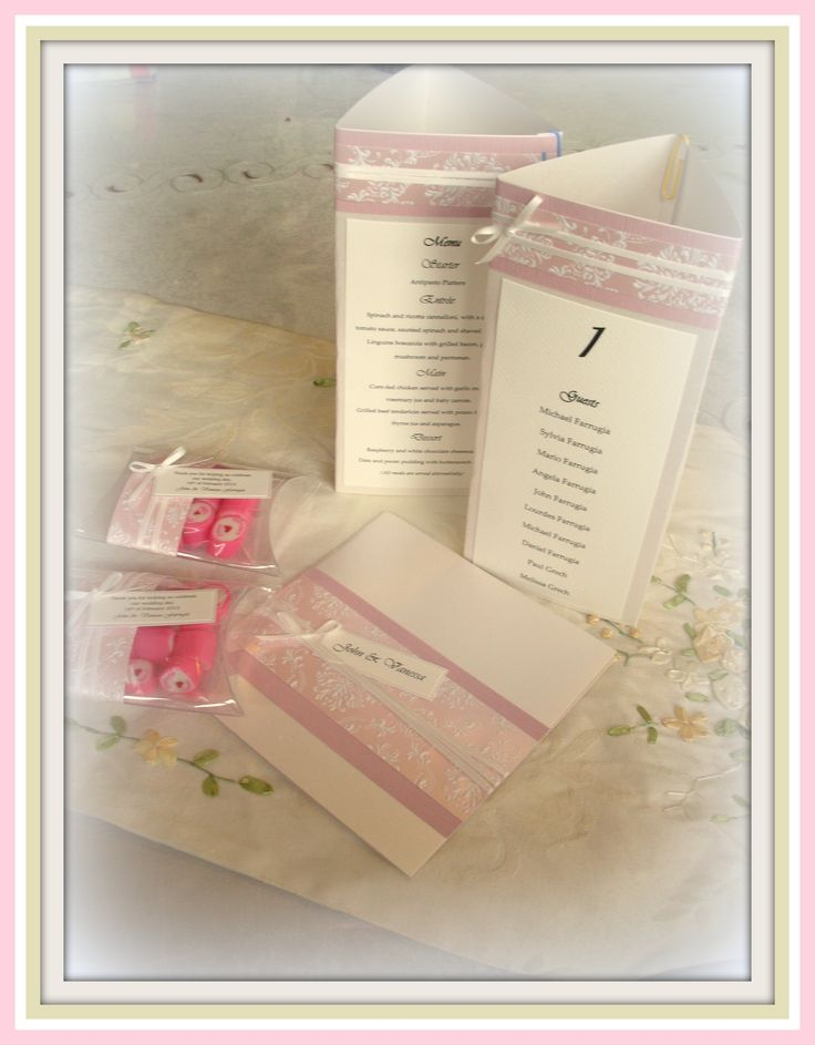 Pink and Ivory bespoke wedding invitations with Matching favour pouches, and table centre pieces, by D'lish Cupcakes & Accessories