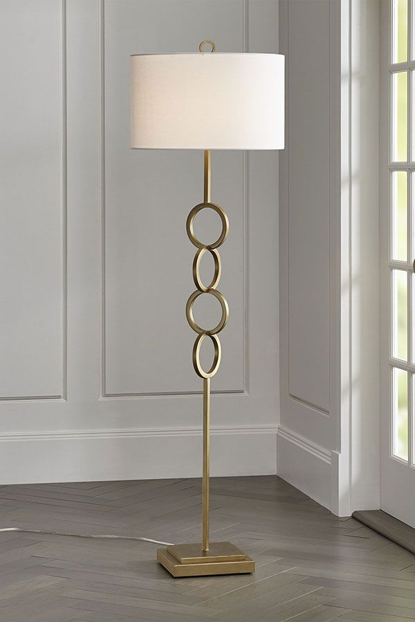 Four Linked Circles Angled For Movement Transform The Basic Floor Lamp Into Something Sculptural Finished In Golden Brass Floor Lamp Brass Floor Lamp Lamp