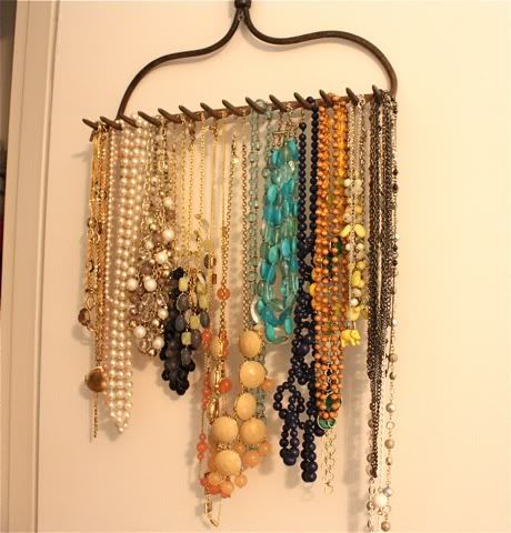 upcycled rake becomes jewelry rack ... so many good ideas for an old rake head ... tool rack, wine glass rack, etc.