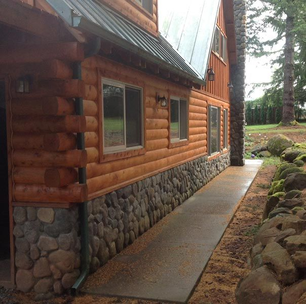 This is what we want for our home....stone the bottom, log siding and tin roof! -brooke
