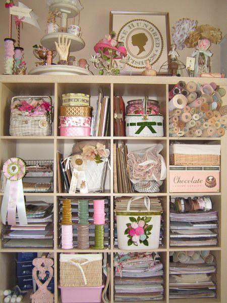 Neatly organized shelves full of shabby chic & pink creativity stuff.