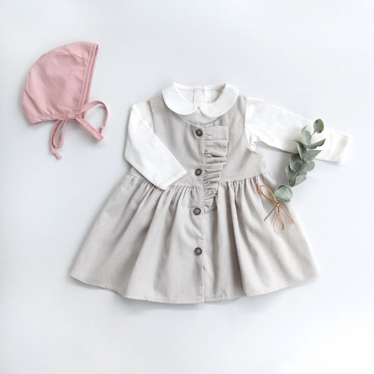 Darling baby little dress with graceful ruffles in the softest corduroy fabric. ♡