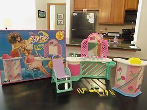 Style Magic Barbie Styling Salon 1988 by Arco. $65.99. No Longer Available from Mattel; Salon chair tilts up and back; Introduced in 1988; 21 Piece set. Includes vanity with opening drawer, chair, hair dryer, nail file, tweezer, mirror, cuticle nipper, scissors, comb, brush, perfume bottle, cold cream jar, hand cream jar, shampoo bottle, compact case, play soap, nail polish bottle, counter and cash register.