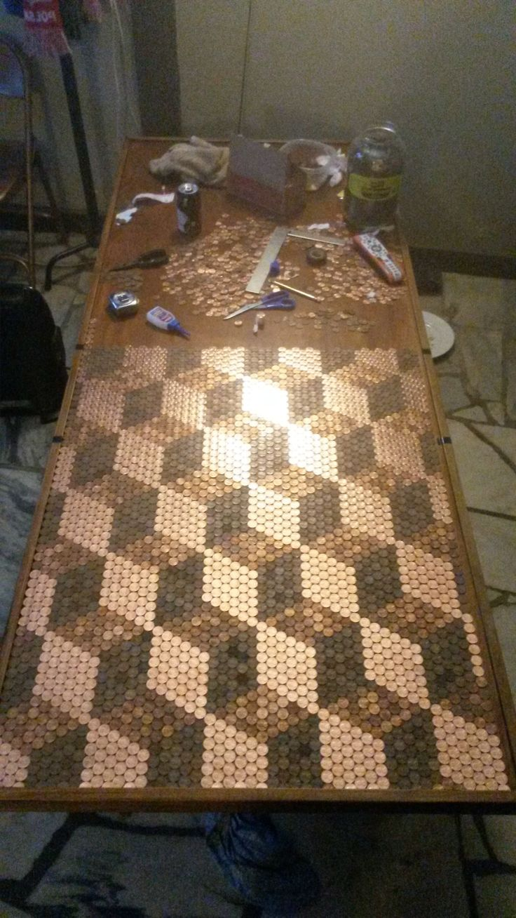 Another penny tabletop, this time in an Escher cube pattern! WOW. Process pics at the link.